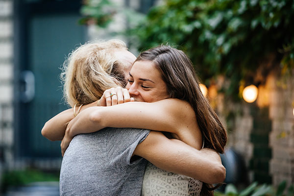 Photo of two white women hugging